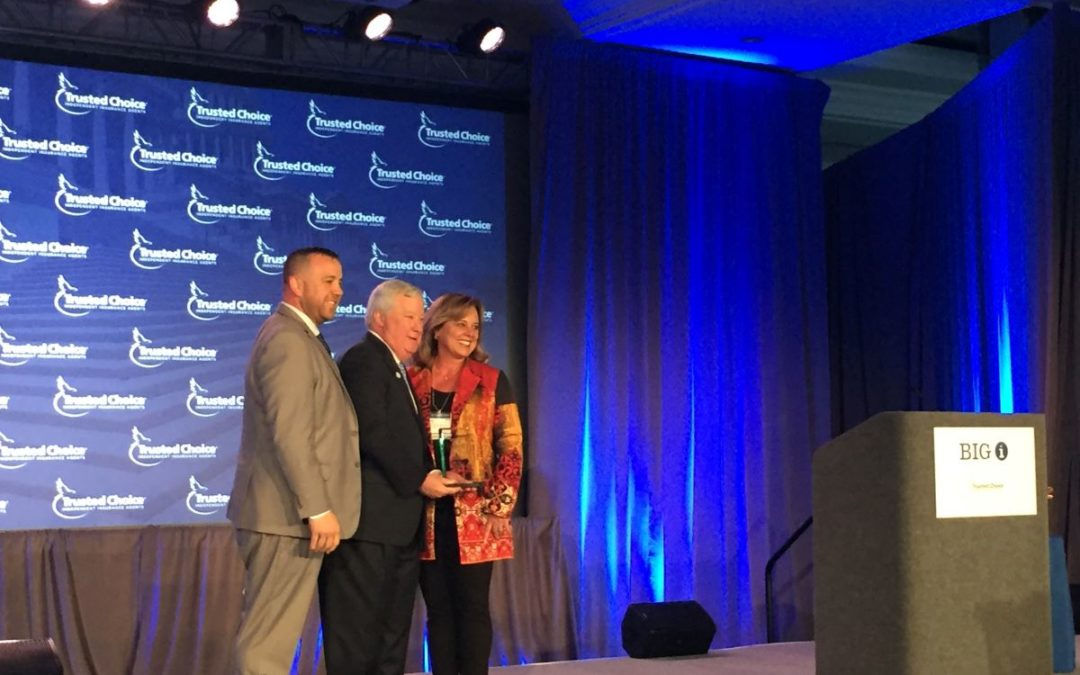 Bryan Bernier and Susy Fischer accept award for PIIAC