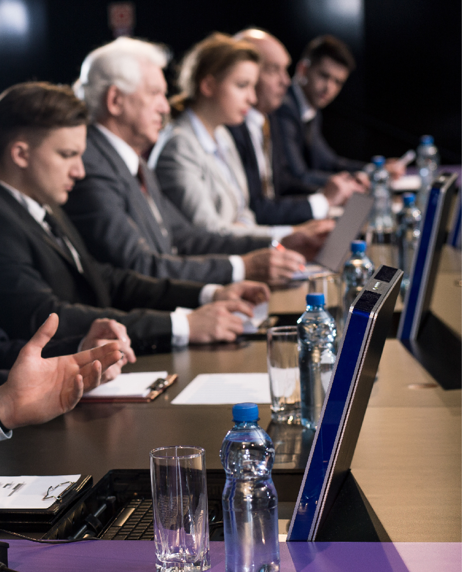 Panel of people sitting at a desk