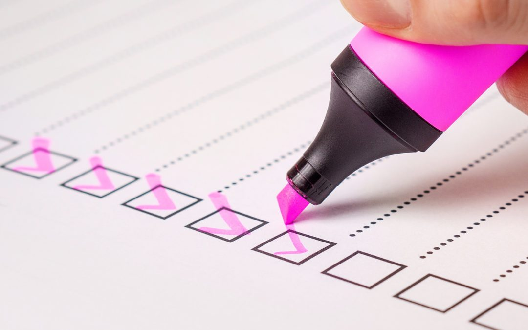 Checklist and forms with pink highlighter