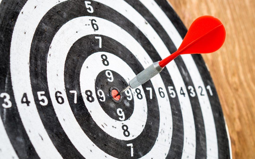Dart in bullseye of target