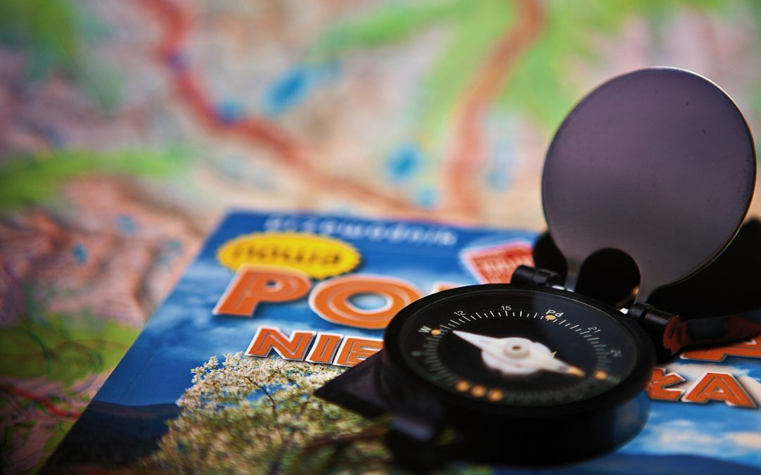 compass with map and guidebook