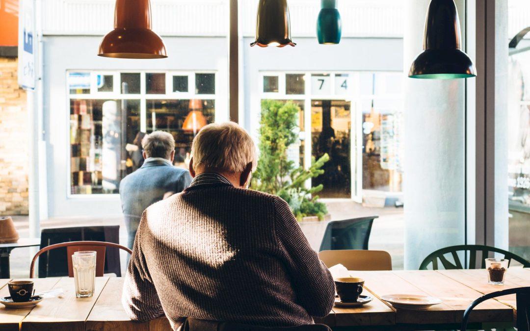 Man sitting in coffee shop working
